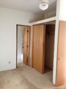 First floor bedroom looking to closet and bathroom door.