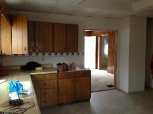 Kitchen toward living room and front door.
