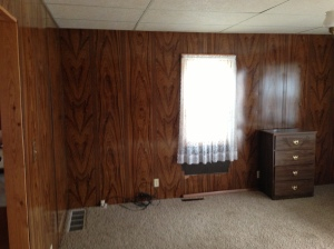 The living room is my favorite! Check out this fabulous Elvis Jungle Room paneling!! Fab!!