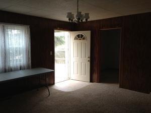Living room to front door.