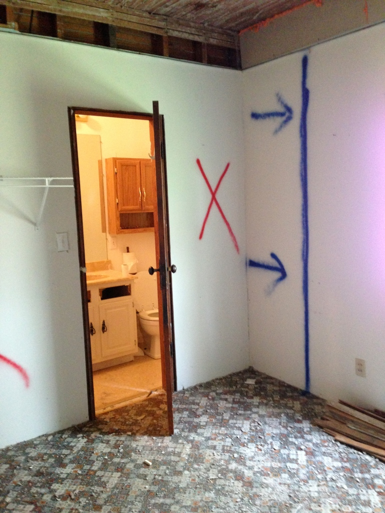 On the other side of the bathroom, the wall will move about 2 feet into the laundry room, making the bathroom a little less than 6 feet wide (rather than its current less than 4-foot width).
