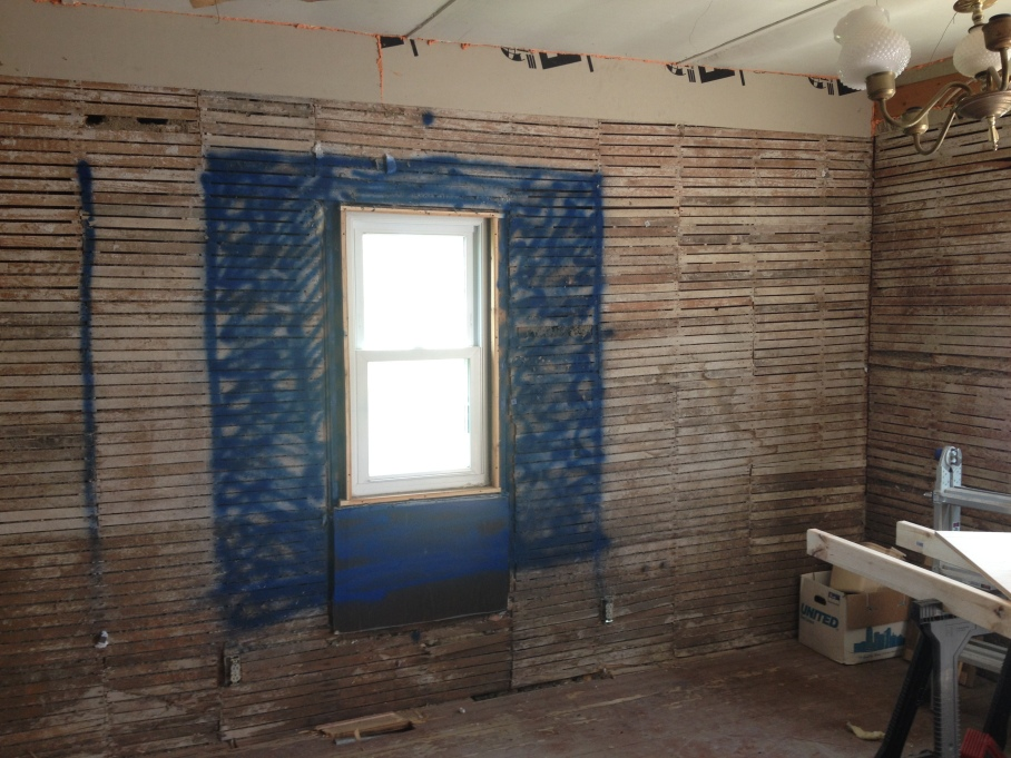 "Blue spray paint says, ""Imagine a window here."""