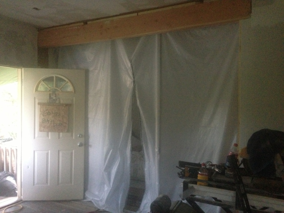 """Our bedroom """"wall"""" on the first floor kept our space relatively less dusty than the remainder of the house."""
