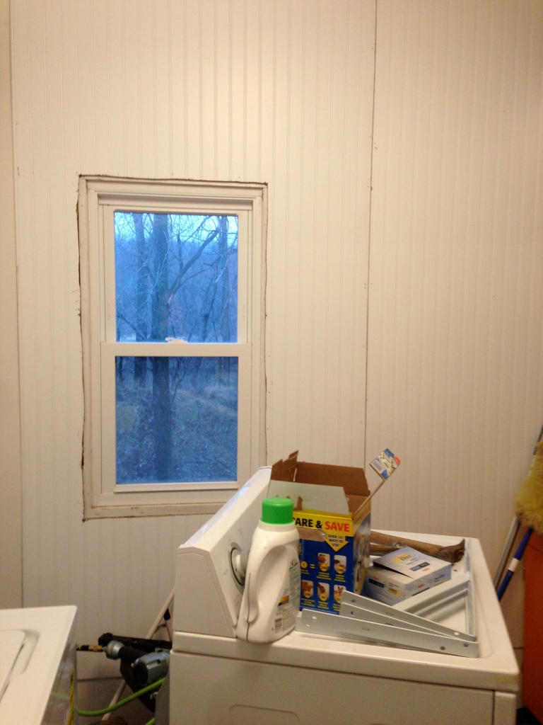 We removed the window's barnwood trim to install the beadboard wall covering.